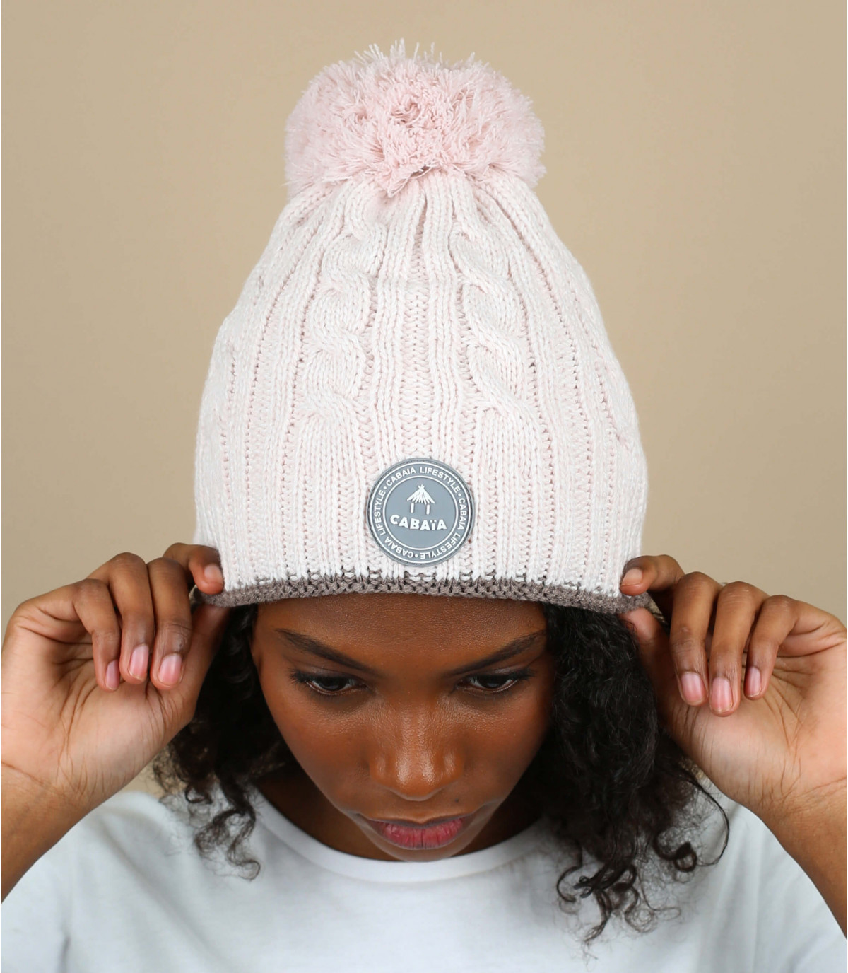 Mütze Zopfmuster Bommel rosa