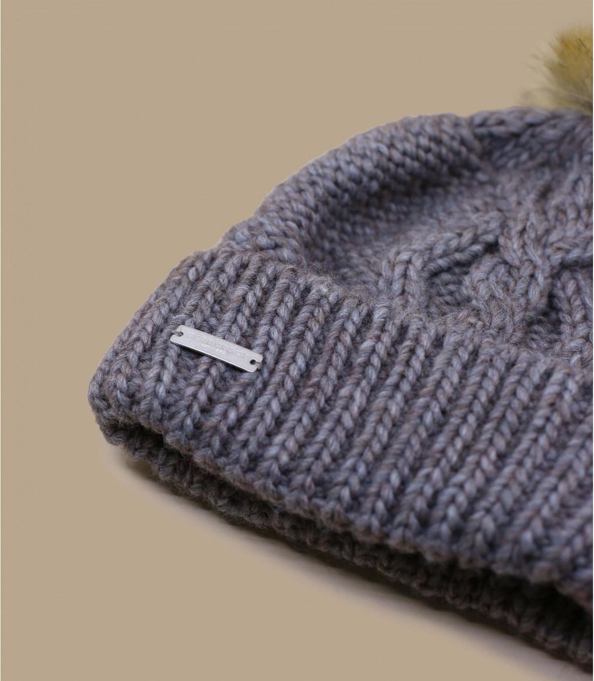 Mütze Revers beige Bommel